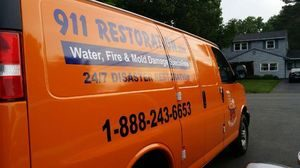 Water Damage Restoration Van At Residential Property