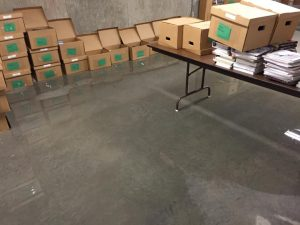 Water Damage and Wall of Boxes